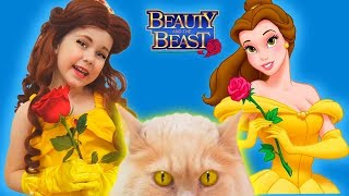 Julia in Princess Belle Dress & Kids Makeup plays with kitty cat