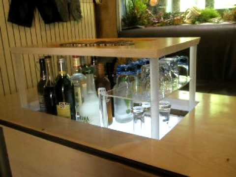 Table basse avec mini bar motoris youtube for Buffet avec table escamotable