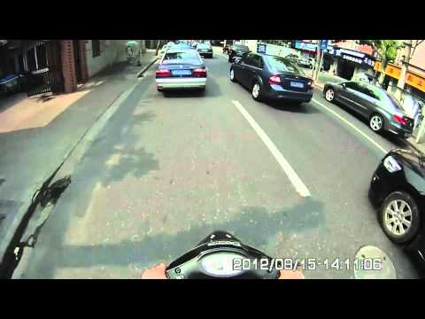 These2Guyz Cubi Cam test - How to ride a motorbike in Shanghai