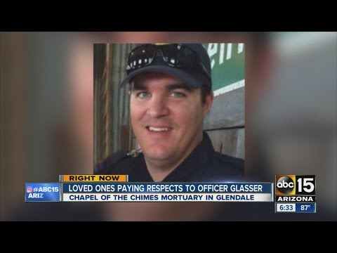 Loved ones paying respects to Officer Glasser