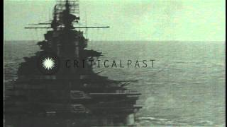 Battleships and Portland class heavy cruiser bombard Peleliu island in Palau, dur...HD Stock Footage