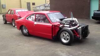 Twin turbo v8 Mazda RX3 drag car start up