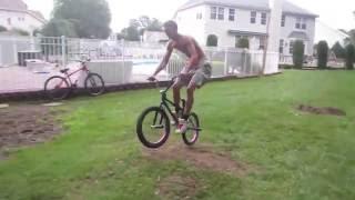 Jumping the BMX bike on homemade dirt ramp!