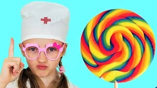 Polina plays with sweet candies