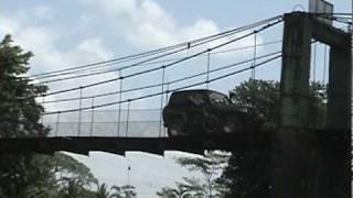 Jeep Crossing A Suspension Bridge In Costa Rica