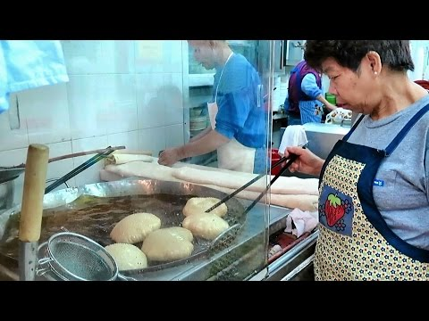 Hong Kong Street Food. The Complicate Art of Making Fried Loaves of Bread