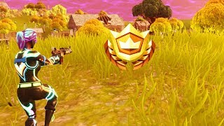 Search Between a Scarecrow, Pink Hotrod and a Big Screen Fortnite Week 2 Challenge Location