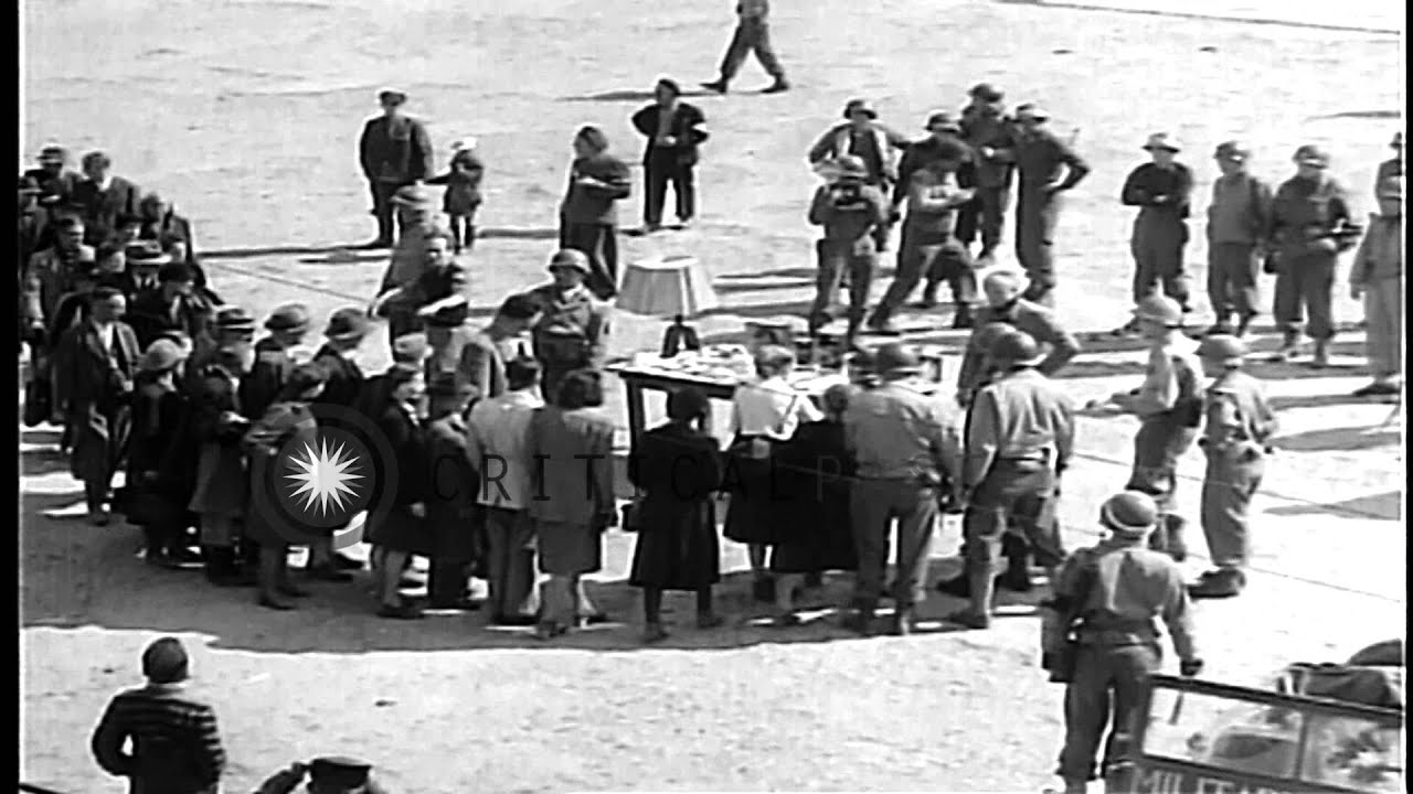 Image result for Civilians view a table displaying Nazi atrocities: Items made of human skin at Bu...HD Stock Footage