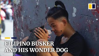 Poor Filipino busks with his loyal friend, a versatile dog with maths skills