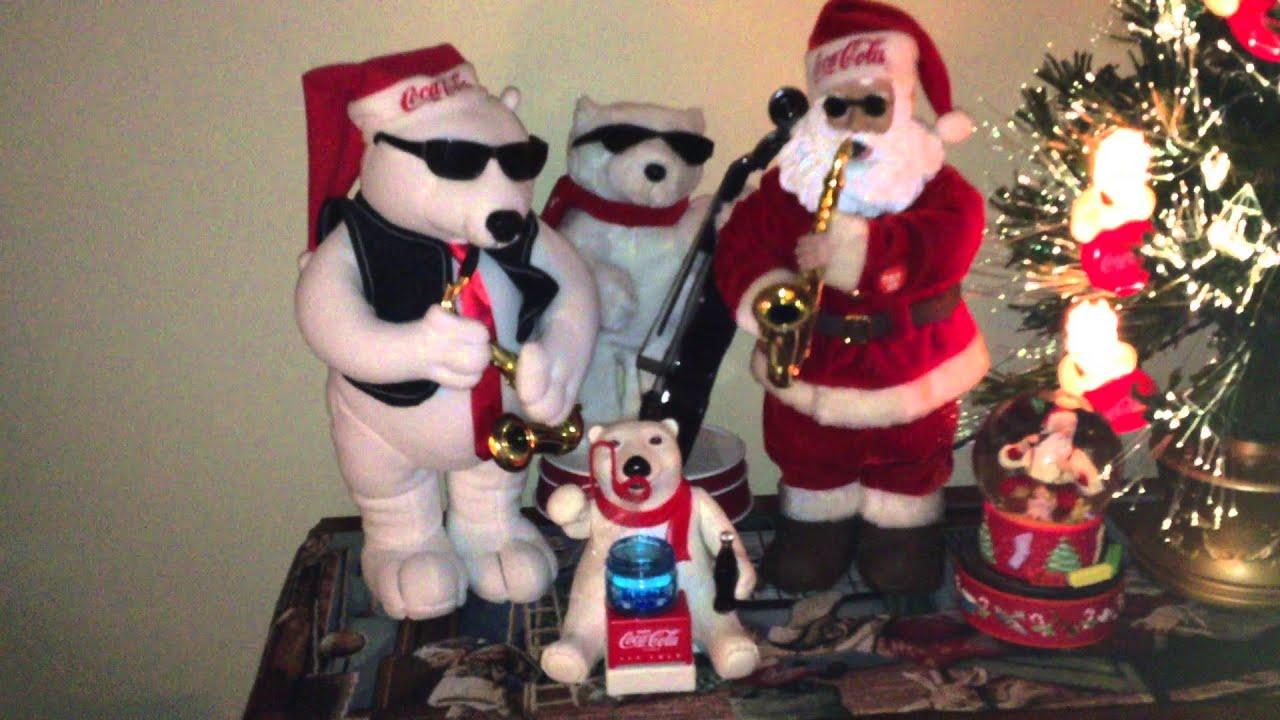 Coca Cola Santa rocking around the Christmas tree with his ...