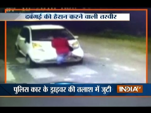 Toll booth worker drag to several meter over car-bonnet for asking toll in Godhra