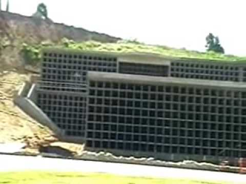 Mass Graves 4 months later Concrete vaults caskets LA