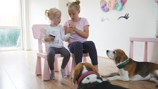 Cute Girl Teaches Her Little Sister How to do Dog Tricks with Beagles