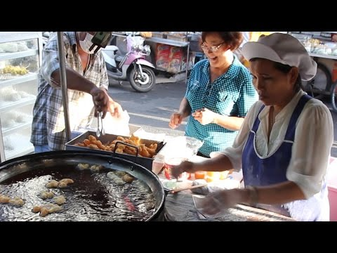 Street Food & Shopping at a Morning Street Market in Thailand. A Thai Food Market in Hat Yai