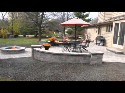 Unilock Patio with Decorative Walls and a Fire Pit