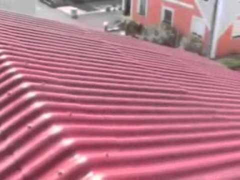 Spray Painting Asbestos Roof Youtube