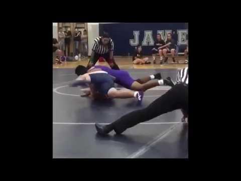 wrestling ref slides across mat