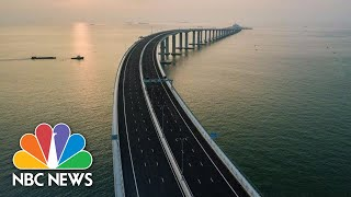 World's Longest Sea-Crossing Bridge Opens In Southern China | NBC News