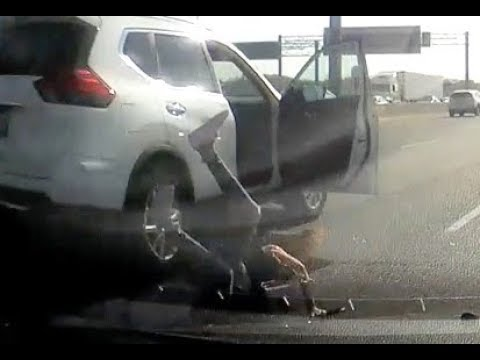 CAUGHT ON CAMERA: Woman jumps from moving car