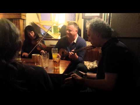 Yvonne Casey on Fiddle, Eoin O'Neill on Bouzouki, Willie Cummins, Bodhran and Christy Mc, Concertina