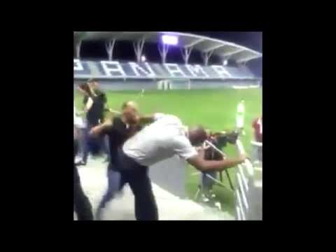 Costa Rica boss Paulo Wanchope fights a security guard during match v Panama