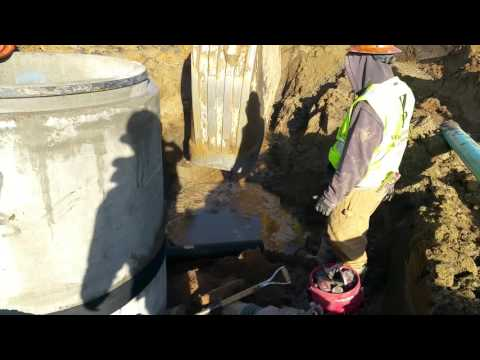 Sanitary sewer install under wet conditions.