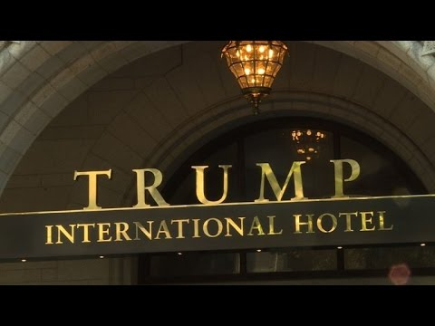 Demonstrators protest in front of new Trump Hotel in Washington