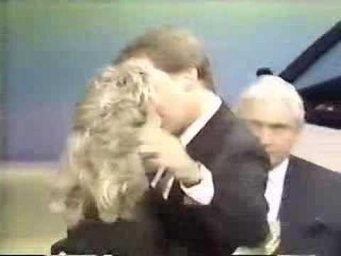 Pat Sajak kisses Vanna White