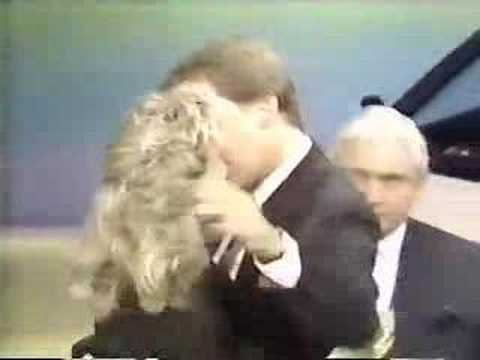 Pat Sajak kisses Vanna White