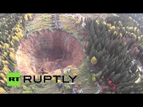 Drone buzzes ever-growing sinkhole in Russia