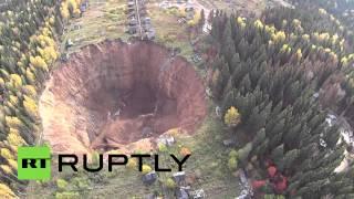 Drone buzzes ever-growing sinkhole in Russia