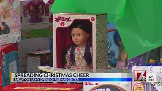 Salvation Army cuts ribbon to Christmas center.