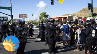 Police and protesters clash outside of Dream City Church during President Trump's visit