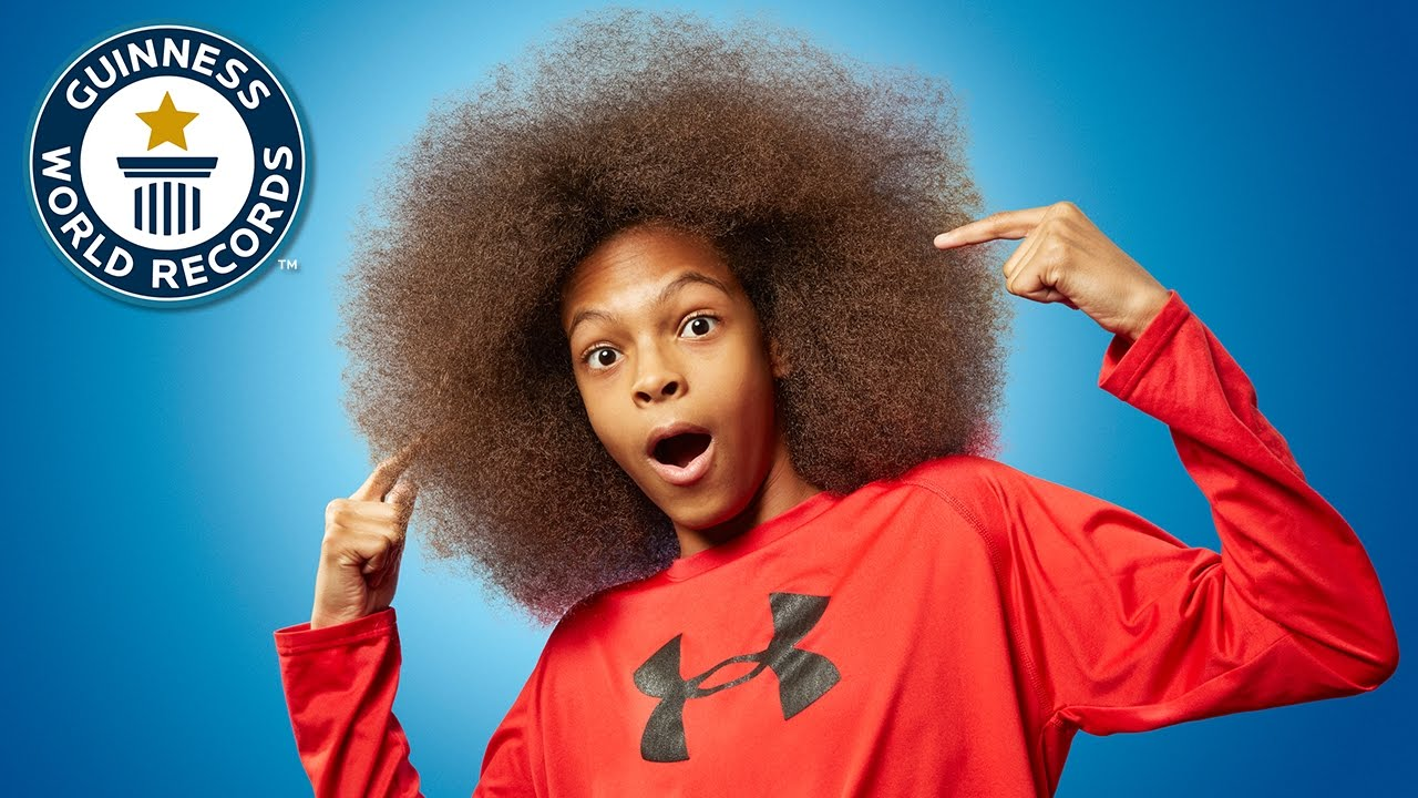 Thirteen Year Old Boy Grows Largest Afro Ever To Get Into Guinness