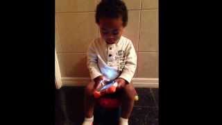 Potty training and playing on his tablet