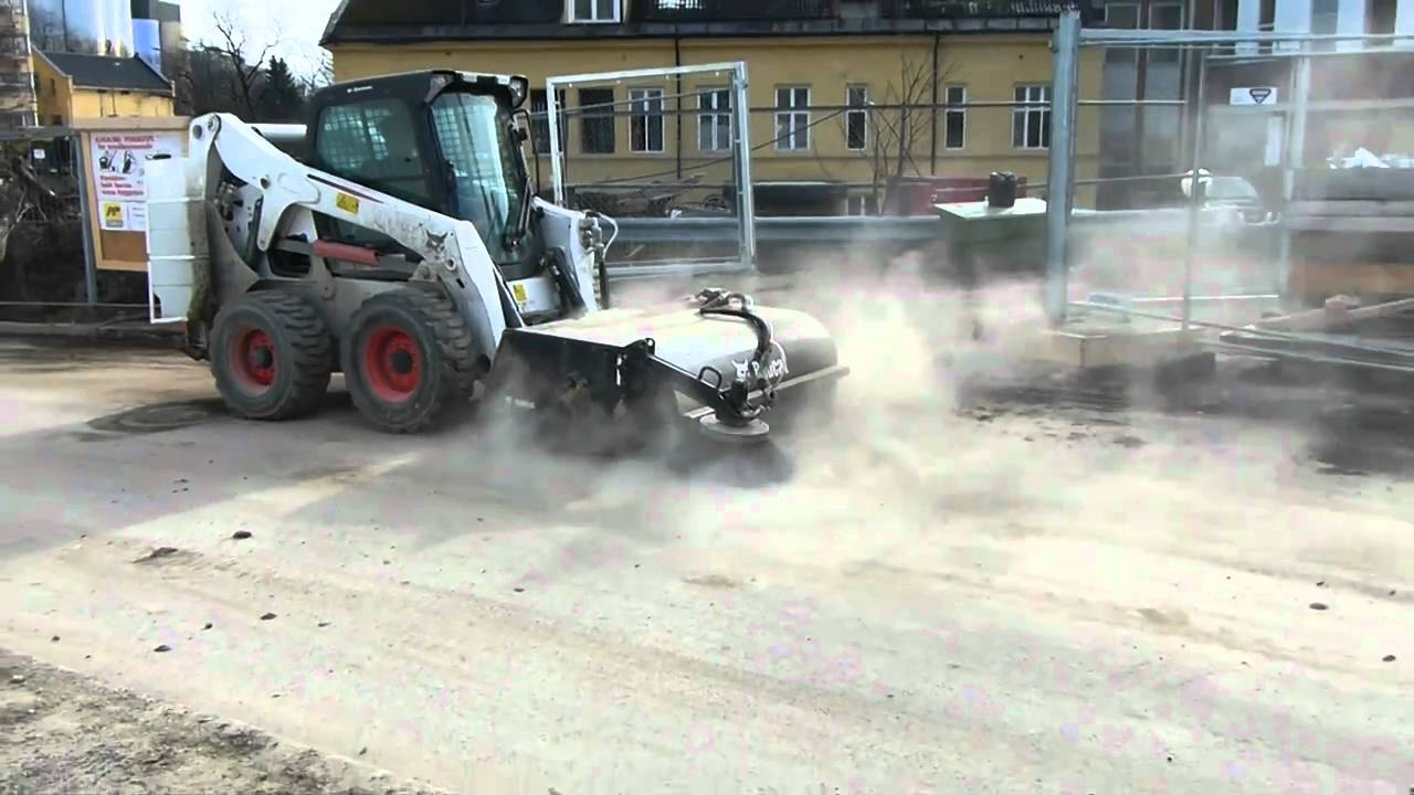 Bobcat S650 Skid Steer With Sweeper Cleaning A Street