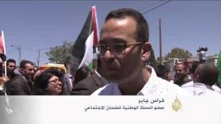 فلسطينيون يتظاهرون احتجاجا على قانون الضمان الاجتماعي