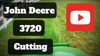 Finishing up that last satisfying strip of grass on my John Deere 3720 Cab Tractor