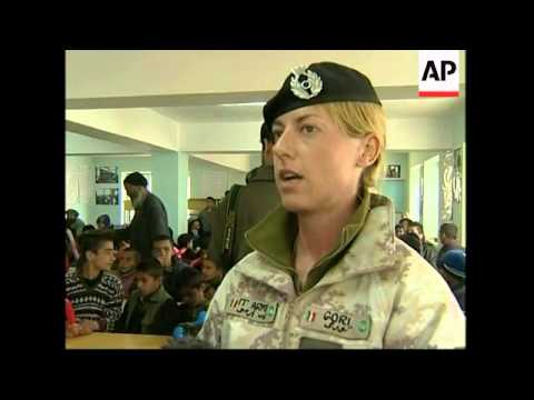 Italian ISAF troops hand out clothes, games, food to orphans
