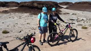 Clachnaben biking  in Scotlad. Evolution ebike with mid Cyc motor and two MTB bikes.