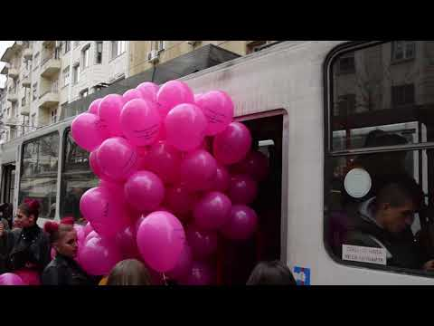 Does she need an extra ticket? Girl gets on a tram with dozens of balloons