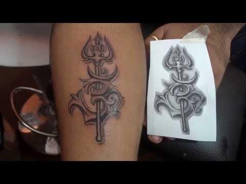 om tattoo by Dev tattoos Dwarka M 9313666999