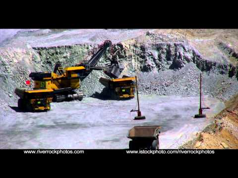 Giant shovels in open pit copper mine in Uath.