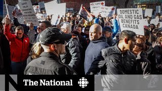 Thousands protest in Calgary as Trudeau meets with oil industry leaders