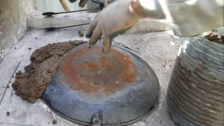 cooking tandoori chicken by a home made tandoor oven