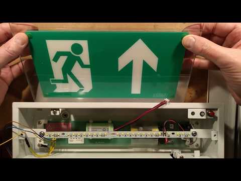 Inside a self-testing emergency exit sign.