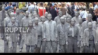Germany: Hundreds of 'clay figures' crawl through Hamburg in G20 protest *EXPLICIT*