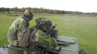FN MAG 7.62 mm GPMG firing from top of vehicle