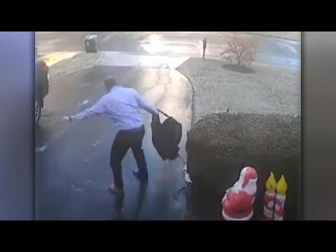 Watch: Man's epic slip down icy driveway