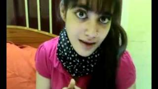 A Very Cute Pakistani Girl singing a song